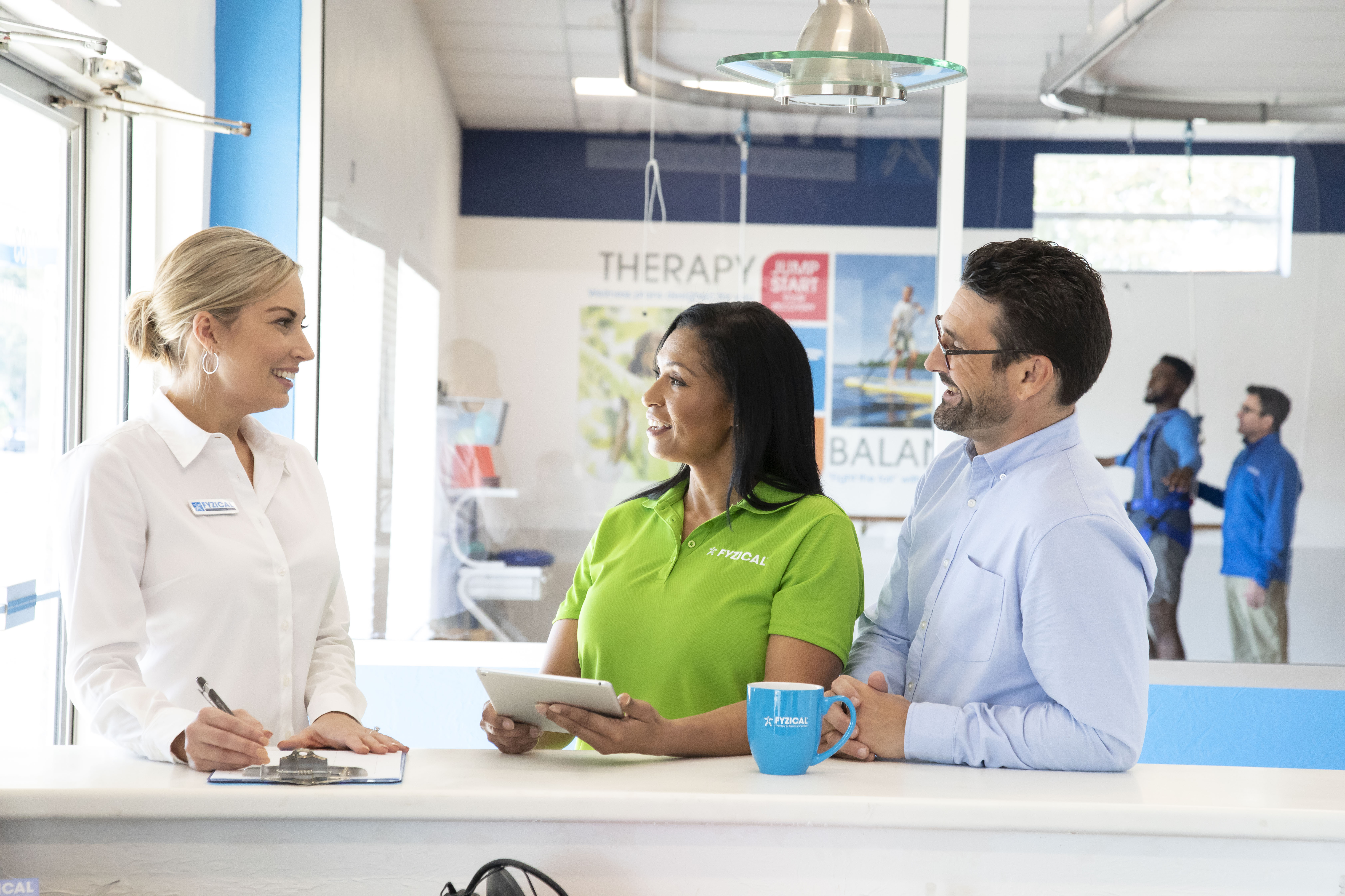 Franchisees Receiving Assistance From FYZICAL Support Staff Member